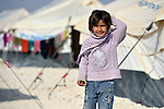 A girl in the Zaatari Refugee Camp, located near Mafraq, Jordan. Opened in July, 2012, the camp holds upwards of 50,000 refugees from the civil war inside Syria. International Orthodox Christian Charities and other members of the ACT Alliance are active in the camp providing essential items and services.