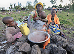 Justine Mukristo cooks a meal for her four children. They were displaced by fighting between forces of rebel Tutsi General Laurent Nkunda and the Congolese government on October 28, 2008, and fled to the provincial capital of Goma, where they have taken refuge with several other families in a Methodist church and adjacent school. Action by Churches Together International has provided food, non-food items, and shelter support for these families. A quarter of a million people have been newly displaced by fighting in the eastern Congo, where some 5.4 million have died since 1998 from war-related violence, hunger and disease.