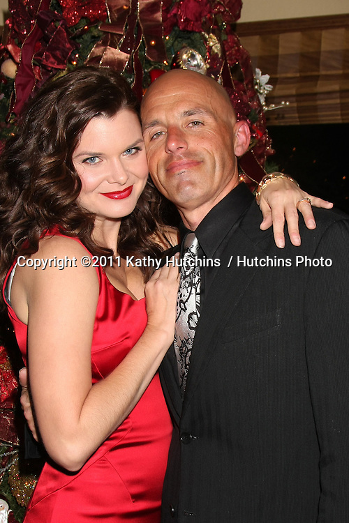 LOS ANGELES - DEC 17:  Heather Tom and husband James Achor at the 2011 Tom / Achor Annual Christmas Party at Private Home on December 17, 2011 in Glendale, CA