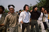 "Seoul, South Korea.May 9, 1987..Students hold a violent anti-government protests at Yunsei University...After two decades of building an economic miracle, in the summer of 1987 tens of thousands of frustrated South Korean students took to the streets demanding democratic reform. ""People Power"" Korean-style saw Koreans from all social spectrums join in the protests...With the Olympics to be held in South Korea in 1988, President Chun Doo Hwan decided on no political reforms and to choose the ruling party chairman, Roh Tae Woo, as his heir. The protests multiplied and after 3 weeks Chun conceded releasing oppositionist Kim Dae Jung from his 55th house arrest and shaking hands with opposition leader Kim Young Sam. Days later he endorsed presidential elections and an amnesty for nearly 3,000 political prisoners. It marked the first initiative of democratic reform in South Korea and the people had their victory."