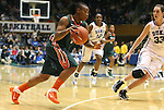 24 February 2012: Miami's Riquna Williams (left) drives against Duke's Haley Peters (33). The Duke University Blue Devils defeated the University of Miami Hurricanes 74-64 at Cameron Indoor Stadium in Durham, North Carolina in an NCAA Division I Women's basketball game.