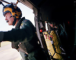 RAF creman watches through open door of Sea King helicopter.