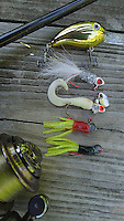 NWA Democrat-Gazette/FLIP PUTTHOFF <br /> Small lures work best for crappie, but other fish bite them as well. Good choices include Arkie Crappie Crank crank bait (top to bottom) Arkie Shinee Hinee jig, Roadrunner curly-tail jig and tube jigs with a red or black body and chartreuse tail.