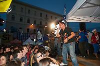 Roma 13 Giugno 2011.Festa a Piazza della Bocca della Verita'   per la vittoria  dei referendum dei  comitati «Vota Sì per fermare il nucleare» e «due Sì per l'acqua bene comune». Il cantante Brusco