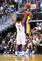 Kobe Bryant of the Lakers is fouled by Nick Young of the Wizards while shooting a 3-point shot. Los Angeles defeated Washington 103-89 at the Verizon Center in Washington, DC on Tuesday, December 14, 2010. Alan P. Santos/DC Sports Box