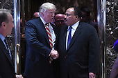 (L-R) President-Elect Donald J. Trump shakes hands with Martin Luther King III as they exit the elevators in the lobby of the Trump Tower in New York, NY, on January 16, 2017.<br /> Credit: Anthony Behar / Pool via CNP