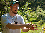 SOUTHBURY,  CT-051817JS14- Volunteer Ben Sonnenberg of Litchfield, releases a female indigo bunting after banding it during a bird banding study Thursday at the Audubon Center Bent of the River in Southbury. <br /> Jim Shannon Republican-American