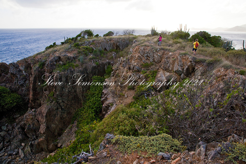 Hikers Janet Simonsen and Brooke Morton along the Tektite trail near Lameshur Bay<br /> St John<br /> US Virgin Islands