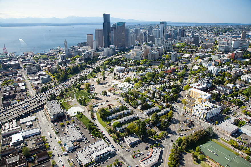 aerial photo of redevelopment of Yesler Terrace, a mixed-income community, with Seattle skyline and Elliott Bay in the background