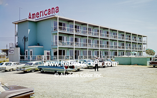 Americana Motel in Ocean City MD. Old cars in the gravel parking lot.