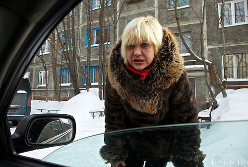 A prostitute solicits clients in Murmansk City, the biggest Arctic city on earth. While the region is full of resources such as metals, oil and gas, the population lives poorly.