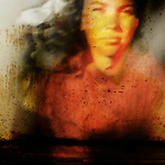 orange and red dream image of a woman staring straight ahead