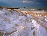 St Joseph, MI   <br /> St Joseph Pierhead Light from the windswept snow covered dunes of North Beach