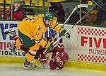 19 February 2016: University of Vermont Catamount Forward Mario Puskarich, a Junior from Fort Walton Beach, FL, checks Boston College Eagle Defenseman Casey Fitzgerald, a Freshman from North Reading, MA, in the third period at Gutterson Fieldhouse in Burlington, Vermont. The Eagles defeated the Catamounts 3-1 in the first game of their weekend series. Mandatory Credit: Ed Wolfstein Photo *** RAW (NEF) Image File Available ***