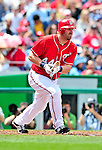 25 April 2010: Washington Nationals' first baseman Adam Dunn hits a grounder to knock in the only run of the game in a win against the Los Angeles Dodgers at Nationals Park in Washington, DC. The Nationals shut out the Dodgers 1-0 to take the rubber match of their 3-game series. Mandatory Credit: Ed Wolfstein Photo