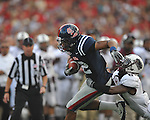 Ole Miss'  Donte Moncrief (12) is tackled by Southern Illinois' Nick King (8) at Vaught-Hemingway Stadium in Oxford, Miss. on Saturday, September 10, 2011.