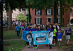 Ohio University students and Athens residents participate in the Interfaith Peace Walk through the city on Sept. 11, 2014. Photo by Lauren Pond