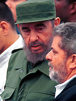 Cuban President Fidel Castro speaks to brazilian Luiz Inacio Lula da Silva, (R) President Workers Party , during a demonstration to demand that exile Luis Posada Carriles reclaimed for terrorism in front of the U.S. Interests Section, today, Nov. 27, 2000 in Havana. Credit: Jorge Rey/MediaPunch
