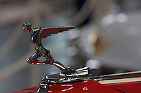 An Art-Deco Hood ornament graces the front of a pre-war Auburn Speedster.