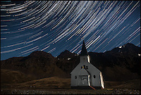 BNPS.co.uk (01202 558833).Pic: SamanthaCrimmin/BNPS..***Please Use Full Byline***..Star trails above Grytviken church in South Georgia...A British Doctors braved freezing conditions to capture unique pictures of the night sky from the tiny British island of South Georgia in the remote South Atlantic...Amateur photographer Samantha Crimmin's stunning photos of the sky at night over South Georgia have left locals so star-struck they have been turned into stamps...Dr Samantha Crimmin was working as an emergency medic for the British Antartic Survey team when she took the celestial images in her spare time...Dr Crimmin used long exposures and plenty of patience to create the incredible shots that show star trails in a perfect circular motion...Her gallery of photos depict the night sky above different locations on the tiny outpost in the south Atlantic...They include one above the Harker Glacier - named after British geologist Alfred Harker - and over the wrecks of two Norwegian whaling ships at Grytviken.