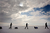 (Left to Right) Heleen, Nastya and Misha trek across frozen Lake Baikal in Siberia, Russia (second day). .They are a group of five people: Justin Jin (Chinese-British), Heleen van Geest (Dutch), Nastya and Misha Martynov (Russian) and their Russian guide Arkady. .They pulled their sledges 80 km across the world's deepest lake, taking a break on Olkhon Island. They slept two nights on the ice in -15c. .Baikal, the world's largest lake by volume, contains one-fifth of the earth's fresh water and plunges to a depth of 1,637 metres..The lake is frozen from November to April, allowing people to cross by cars and lorries.