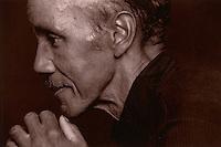 Profile portrait of an elderly man.