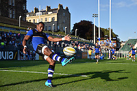 Semesa Rokoduguni of Bath Rugby practises his kicking during the pre-match warm-up. West Country Challenge Cup match, between Bath Rugby and Gloucester Rugby on September 26, 2015 at the Recreation Ground in Bath, England. Photo by: Patrick Khachfe / Onside Images