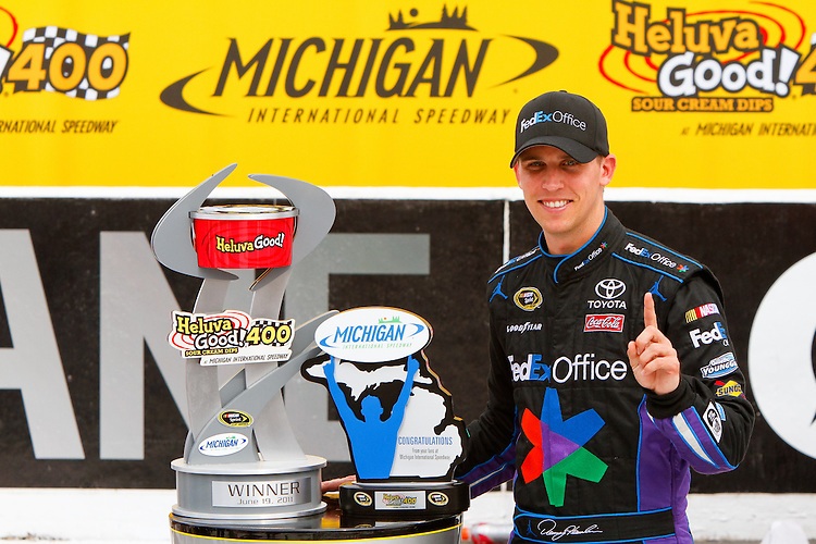 19 June, 2011: Denny Hamlin poses with his trophies after winning the 43rd Annual Heluva Good! Sour Cream Dips 400 at Michigan International Speedway in Brooklyn, Michigan. (Photo by Jeff Speer :: SpeerPhoto.com)