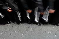 The Holy Week participants (Nazarenos) wear rope belts with three knots (symbolizing three religious vows - poverty, chastity and obedience) during the Easter celebration in Malaga, Spain, 5 April 2007.