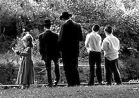 The Burger family of Passaic prays in Third Ward Park during Tashlich, an annual ceremony in which Jews cast away sin by tossing stones into water.