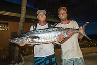 Namotu Island Resort, Nadi, Fiji (Monday, June 6 2016): Ben Wilson (AUS) and Kai Otton (AUS) with a 25kg spainish mackeral. The Fiji Pro, stop No. 5 of 11 on the 2016  WSL Championship Tour, witnessed heated head-to-head match-ups as the world's best surfers fought through elimination Round 2 in four-to-six foot (1 - 2 metre) waves at Cloudbreak. Round Two was completed with the new longer period swell from the West slowly dropping during the day.  The contest was looking at a number of lay-days due to the  dropping swell so it gave the surfers on Namotu a chance to celebrate Taj Burrow's birthday and his retirement.  Photo: joliphotos.com