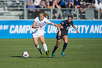 Cary, North Carolina - Sunday December 6, 2015: Rebecca Quinn (5) of the Duke Blue Devils keeps the ball away from Charlotte Williams (12) of the Penn State Nittany Lions during first half action at the 2015 NCAA Women's College Cup at WakeMed Soccer Park.  The Nittany Lions defeated the Blue Devils 1-0.