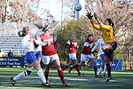 24 November 2013: Arkansas' Cameron Carter (right) catches the ball as Duke's Kaitlyn Kerr (left) and Arkansas' Hailey Pescatore (3) watch. The University of Arkansas Razorbacks played the Duke University Blue Devils at Koskinen Stadium in Durham, NC in a 2013 NCAA Division I Women's Soccer Tournament Third Round match. Duke advanced by winning the penalty kick shootout 5-3 after the game ended in a 2-2 tie after overtime.