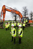 Newark Academy pupils Eva Trickett, 11, and Byron Watson, 12, are watched by their fellow pupils as they dig the first sod at the site for the new school, being built by Kier Construction.