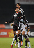 DC United midfielder Andy Najar (14) goes up to head the ball.   DC United tied The Colorado Rapids 1-1, at RFK Stadium, Saturday  May 14, 2011.