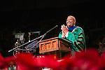 Ohio University President Roderick McDavis applaudes the class of 2015 during fall commencement. Photo by Ben Wirtz Siegel