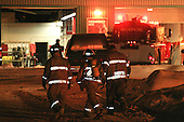 volunter firemen respond to a call in the early morning hours in January for a fire at the municipal garage in Chertsey, which also houses the fire department