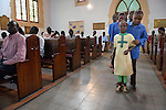 A children's choir enters a worship service of Nuer refugees from South Sudan who live in Cairo, Egypt. The service took place at St Andrews United Church of Cairo.