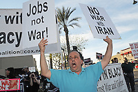 Mesa, Arizona. February 23, 2012 - As Republican candidates debated in the Mesa Arts Center, protesters including undocumented students, tea partiers, occupy movement members and Syrian president opponents, shouted slogans and held up signs and placards outside. In this photograph, Mitch Rubin, of the End the War Coalition, protests outside where the Republican Presidential Primary debate took place in the city of Mesa. Rubin and his group oppose a unilateral attack of the U.S. against Iran. Photo by Eduardo Barraza © 2012