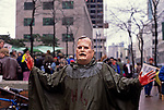 War protester at the Federal Building in downtown Seattle with a George H W Bush mask on protesting the US involvement in the Persian Gulf January 15 deadline 1991 Seattle Washington State USA