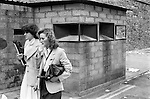 Derry Northern Ireland Londonderry. 1979. Two smartly dressed women walking past a British Army check point.