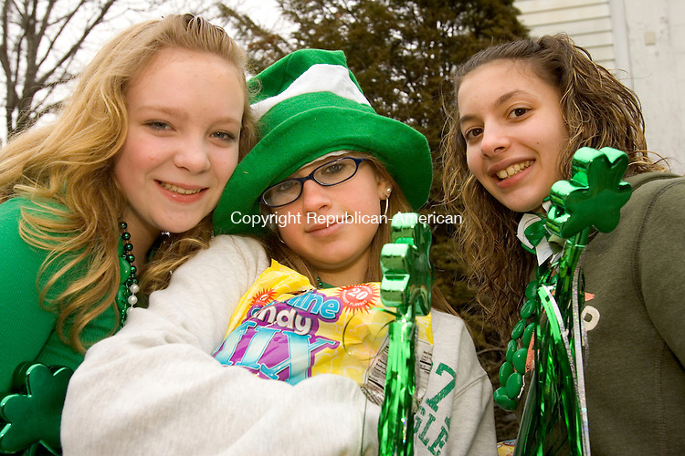 WATERBURY, CT--10 MARCH 2007--031007JS27- Colleen Rush, 12, of Waterbury, Molly Goggins, 13, of Litchfield and Laura Longo, 13, of Waterbury at the annual Waterbury St. Patrick's Day Parade on Saturday. The parade is organized by the Ancient Order of Hibernians. <br /> Jim Shannon / Republican-American