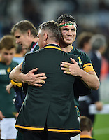 Francois Louw of South Africa embraces Head Coach Heyneke Meyer after the match. Rugby World Cup Bronze Final between South Africa and Argentina on October 30, 2015 at The Stadium, Queen Elizabeth Olympic Park in London, England. Photo by: Patrick Khachfe / Onside Images