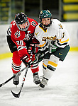 30 October 2009: Northeastern University Huskies' defenseman Katy Applin, a Senior from Palmer, Alaska, locks sticks with University of Vermont Catamount defenseman Kailey Nash, a Sophomore from Middletown, RI, at Gutterson Fieldhouse in Burlington, Vermont. The Catamounts were shut out by the visiting Huskies 3-0. Mandatory Credit: Ed Wolfstein Photo