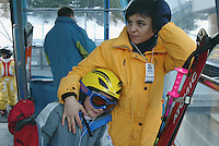 Switzerland. State of Ticino. Airolo. A mother and her daughter Micaela Ruef use a cable car to access the Peschün ski resort. Model released. © 2005 Didier Ruef