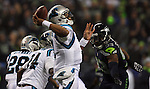 Carolina Panthers quarterback Kam newton (3) passes against the Seattle Seahawks  in the NFC Western Division Playoffs at CenturyLink Field  on January 10, 2015 in Seattle, Washington. The Seahawks beat the Panthers 31-17. ©2015. Jim Bryant Photo. All Rights Reserved.