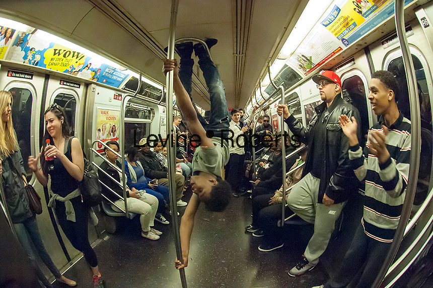 A performer performs for subway riders in New York on Saturday, April 19, 2014. (© Frances M. Roberts)