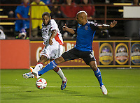 Santa Clara, California -Saturday, March 29, 2014: Andrew Farrell of NE Revolution kicks the ball while being defended by Jordan Stewart of SJ Earthquakes at Buck Shaw Stadium. Final Score: SJ Earthquakes 1, NE Revolution 2
