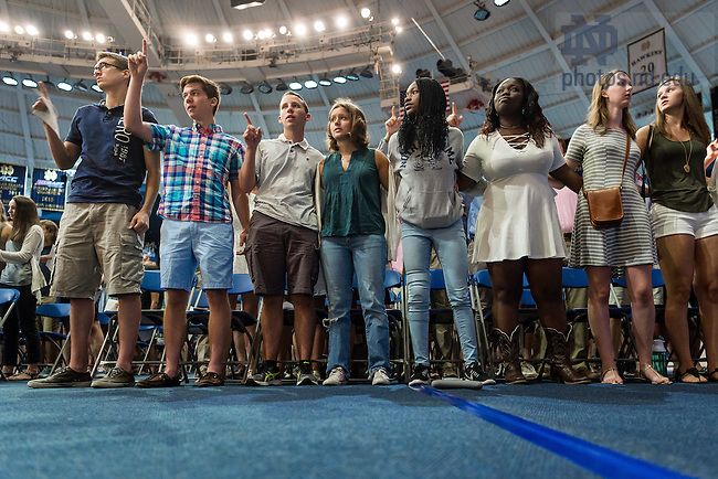 August 21, 2016; First year students sing the Alma Mater at the 2016 Welcome Weekend Mass. (Photo by Matt Cashore/University of Notre Dame)