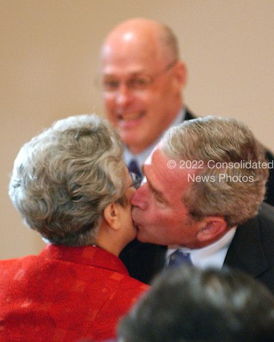 Washington, D.C. - May 24, 2007 -- United States President George W. Bush kisses Chinese Vice Premier Wu Yi, special envoy of Chinese President Hu Jintao, prior to the meeting of the United States - China Strategic Economic Dialogue at the White House in Washington, D.C. on Thursday, May 24, 2007.  The U.S. - China Strategic Economic Dialogue promotes economic cooperation and the growth of U.S. - China relations..Credit: Ron Sachs / CNP